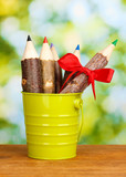 Colorful wooden pencils in pail