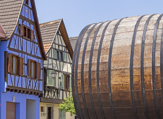 Alsace village, house with old barrel. France.