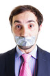 Portrait of a scared businessman with duct tape on mouth
