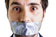 Scared businessman with duct tape on mouth