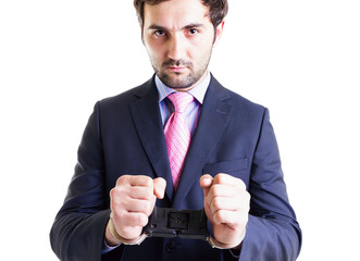 Businessman with shackles on his hands