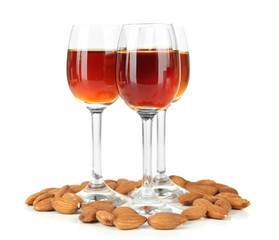 Glasses of amaretto liquor and roasted almonds, isolated