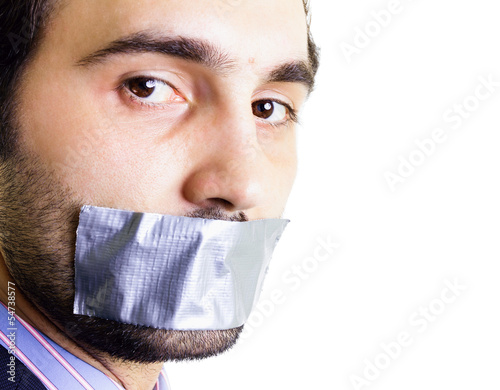 Businessman with duct tape on mouth