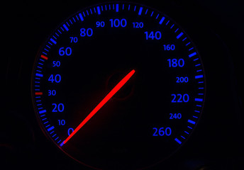 automobile tachometer on blue