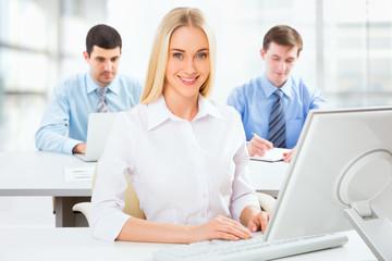 Cute businesswoman in an office
