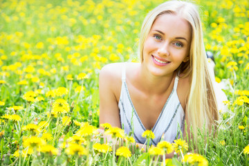 Beautiful young woman among the flowers