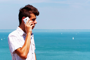 Teenager boy calling by cellular phone