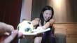 Постер, плакат: Young asian woman fights for cake