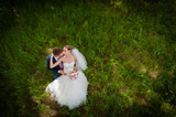 Groom and  bride on green glade