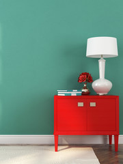 Red chest of drawers and lamp
