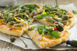 Pizza with arugula, zucchini and capers.