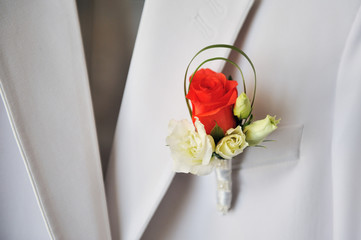 groom's red and white rose boutonniere