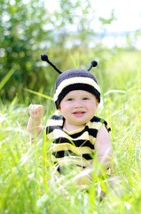 baby in bee costume outdoors