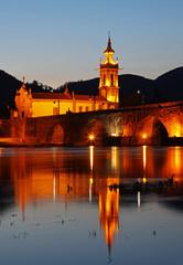 The old romanic bridge of Ponte de Lima after sunset