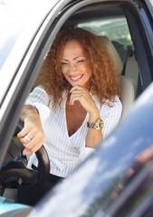 Beautiful redhead woman behind steering wheel
