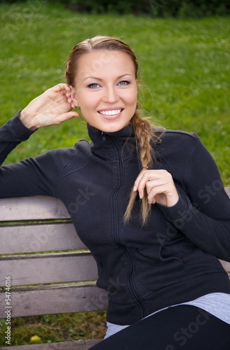 Young beautiful sporty brunette woman in a park