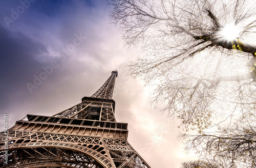 Magnificence of Eiffel Tower, view of powerful landmark structur