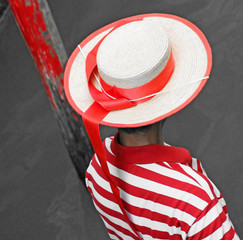 detail of the hat and striped Jersey of the Venetian gondolier i