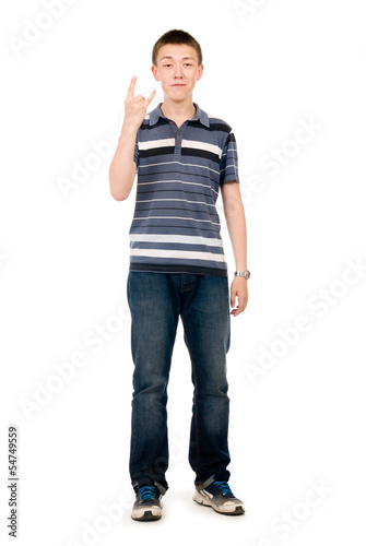 portrait of young man doing a rock and roll symbol