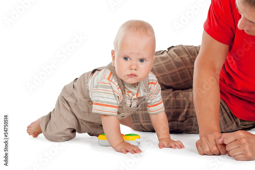 Baby boy playing with his father on the floor