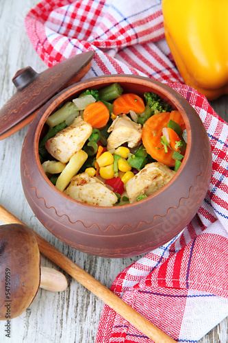 Baked mixed vegetable with chicken breast in pot,
