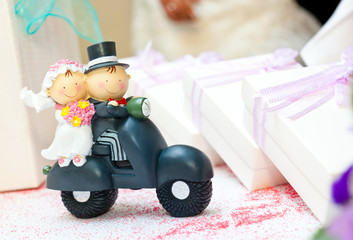 Cake topper 	- Husband and wife on the Vespa