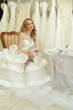 Beautiful bride in luxury interior on background of wedding dres