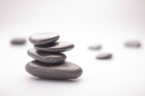 massage stones on white background