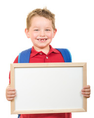 Education concept with child wearing backpack and holding sign