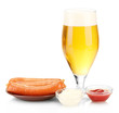 Beer and grilled sausages isolated on white