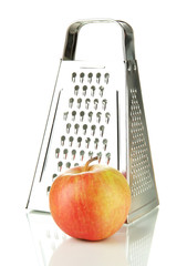 Metal grater and apple, isolated on white