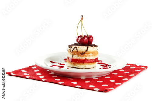 Tasty biscuit cake on plate isolated on white