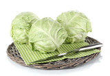 Cabbage on napkin on wicker tray isolated on white