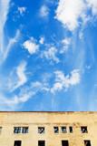 blue sky above furbished home poster
