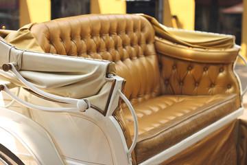 Yellow carriage sofa on summer city street