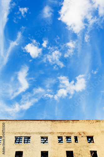 blue sky above furbished home