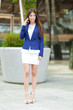 Young businesswoman talking at the phone in the city