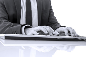 Closeup of businessman typing on computer keyboard
