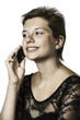 Girl phoning with cellphone in the evening dress
