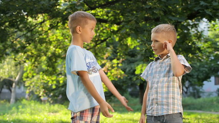 two pleasant young boy introduced in the park during the game