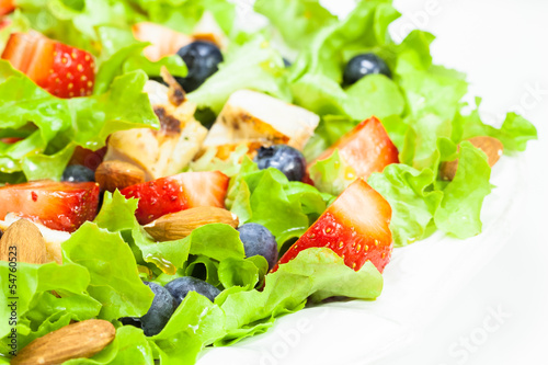 Berry salad with chicken, almond and lettuce. Summer salad