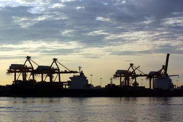 port warehouse with container cargo and crane bridge