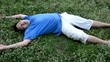 An Asian guy is drop dead on the ground, turning his face up