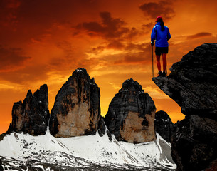 Girl looking at the Tre cime di Lavaredo , Dolomite Alps, Italy