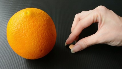 A tablet of vitamin c supplement compare to orange