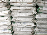 Pile of white paper sacks in warehouse