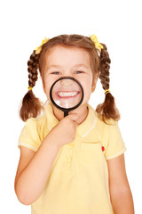 Little girl smiling through magnifying glass.