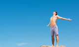 shirtless man against blue sky
