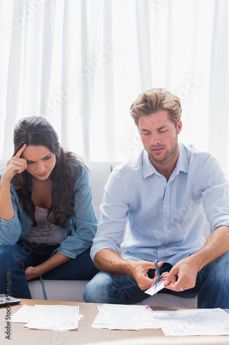 Worried couple doing their accounts together