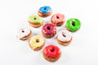 Several colorful fondant croissant and donut mixture
